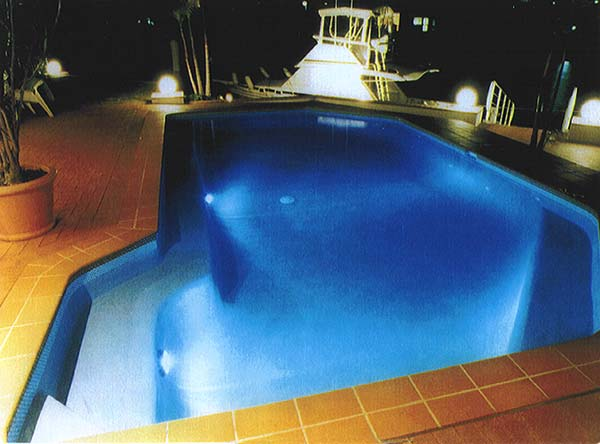 swimming pool glowing at night